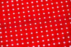The piece of red fabric in white dot Royalty Free Stock Photos