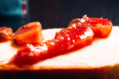 Piece of red fish on bread closeup. Piece of red fish on  bread closeup Royalty Free Stock Image