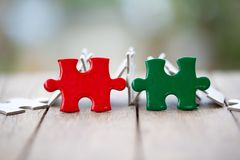 Piece of Red and green  jigsaw puzzle On the old wood. teamwork concept.  symbol of association and connection. business strategy royalty free stock photography
