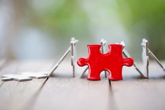 Piece of Red   jigsaw puzzle On the old wood. teamwork concept.  symbol of association and connection. business strategy.  stock photos