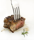 Piece Of Red  Meat Steak On A Fork Royalty Free Stock Images