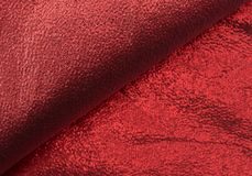 Red metallic cloth. A piece of red metallic cloth folded showing the backing Stock Photo