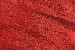 Red metallic cloth. A piece of red metallic cloth that is wrinkled Royalty Free Stock Image