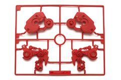A piece of red plastic scale model kit set with futuristic robotic parts Stock Photo