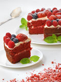 Piece of red velvet cake on plate, studio shot Royalty Free Stock Photography