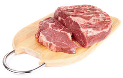 Piece of ribeye on cutting plank. Isolated with soft shadow Royalty Free Stock Photos