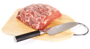Piece of ribeye with knife on cutting plank Royalty Free Stock Photo