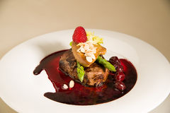Piece of roasted meat in cherry sauce, asparagus and raspberry Stock Photography