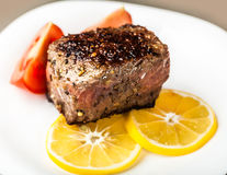 Piece of roasted meat with Royalty Free Stock Image