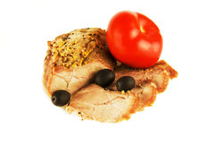 A piece of roasted meat with olives and Midori on a white backgr Royalty Free Stock Photos