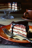 Piece of rustic cake with chocolate icing Royalty Free Stock Image