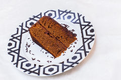 A piece of Sacher torte on a plate Stock Photography