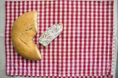 Piece of salami near a savoury doughnut Stock Photography