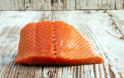Piece of salmon. Isolated on rustic background Stock Image