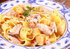 Piece of salmon fillet with tagliatelle, cream sauce Royalty Free Stock Photography