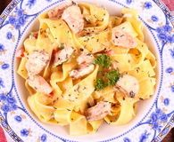 Piece of salmon fillet with tagliatelle, cream sauce Royalty Free Stock Photo