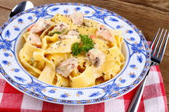 Piece of salmon fillet with tagliatelle, cream sauce Stock Images