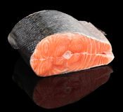 Piece of salmon isolated on black Stock Photos