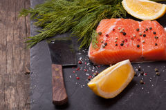 Piece of salmon. With spices and lemon royalty free stock photography