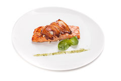A piece of salmon steak with bacon and cheese. Stock Images