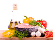 Piece of a salmon with vegetable and olive oil Stock Image