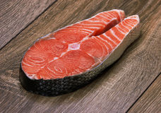 Piece of a salmon on a wood Stock Photos