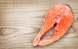 Piece of salmon on wooden background Stock Photography