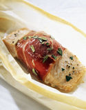 Piece of salmon wrapped in raw ham Royalty Free Stock Photo