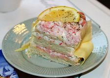 A piece of sandwich cake with salmon and shrimp royalty free stock image