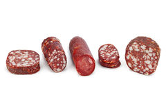 Piece of sausage Stock Images