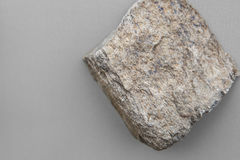 Piece of schist rock. Over grey background. Metamorphic rock coming from Malaga mountains, Spain royalty free stock images