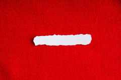 Piece scrap paper blank copy space on red fabric textile material Stock Photography