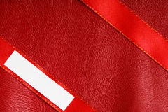 Piece scrap paper blank copy space on red leather background Stock Images