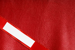 Piece scrap paper blank copy space on red leather background Stock Image