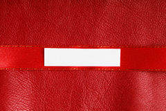 Piece scrap paper blank copy space on red leather background Royalty Free Stock Photos