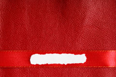 Piece scrap paper blank copy space on red leather background stock photos