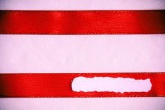 Piece scrap paper blank copy space red ribbon cloth background Royalty Free Stock Photos