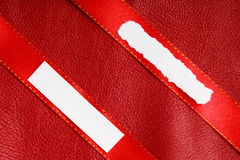 Piece scrap papers blank copy space on red ribbon leather background Royalty Free Stock Images