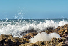 Piece of sea foam against waves Stock Photography