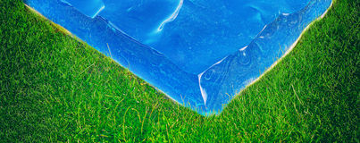 Piece of sea on the grass Stock Photo