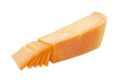 Piece and several slices of Dutch cheese Stock Images