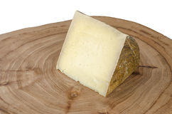 Piece of sheep milk cheese. Royalty Free Stock Images