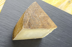 Piece of sheep milk cheese. Stock Photo