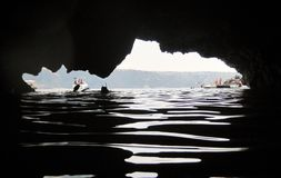A piece of sky by cave. An amazing view inside a sea cave Royalty Free Stock Photography