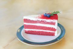 Piece of sliced red velvet cake in ceramic plate on marble table stock photos