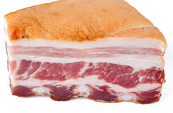 Piece of smoked bacon. On white with slight shadow Stock Photo