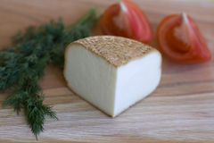 Piece of smoked cheese Royalty Free Stock Photos