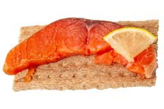 Smoked salmon on a rye biscuit royalty free stock image