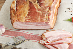 A piece of smoked pork - loin on a linen napkin Royalty Free Stock Photo