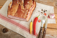 A piece of smoked pork - loin on a linen napkin Stock Images